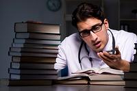 Medical student preparing for university exams at night