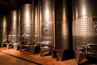 cellar with wine barrels. cellar with modern metal wine barrels rows