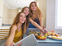 teen girls best friends selfie photo having lunch. teen girls best friends selfie photo having lunch eating at kitchen