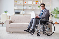 Dsabled businessman on wheelchair working home. Disabled businessman on wheelchair working home