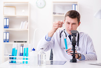 Male doctor looking at lab results in hospital