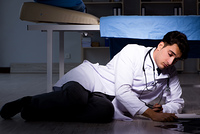 Doctor working night shift in hospital after long hours