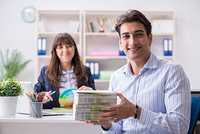 Pulisher discussing book order with customer. Publisher discussing book order with customer