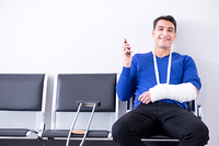 Desperate man waiting for his appointment in hospital with broke. Desperate man waiting for his appointment in hospital with broken arm. Desperate man waiting for his appointment in hospital with broke