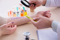 Doctor testing allergy reaction of patient in hospital