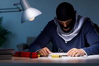 Terrorist bomber preparing dynamite bomb