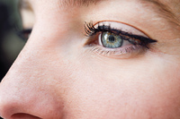 Close-up shot of young woman's eye. Woman with blue eyes.