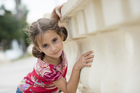 Adorable little girl combed with pigtails outdoors.