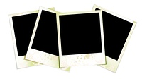 Collection of four blank polaroid photographs fanned out