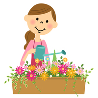 花に水やりする女性