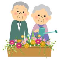 花に水やりするシニア夫婦