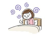 朝の体調がすぐれない若い女性