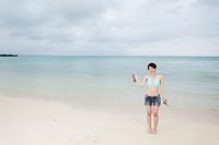 ビーチと女性観光客