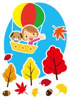 秋 気球で空の旅を楽しむワンちゃんと女性