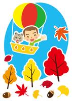 秋 気球で空の旅を楽しむ猫と男性