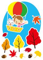 秋 気球で空の旅を楽しむ白猫と女性
