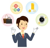 ブランド品の査定をするビジネスマン