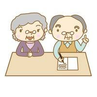 ノートに書くシニア夫婦