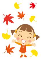 秋の彩りを喜ぶ少女