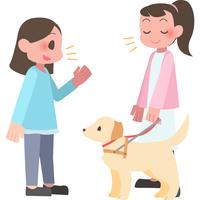 視覚障害者に話しかける女性