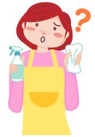 掃除道具を持って悩む主婦