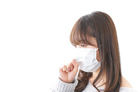 風邪をひいた女性