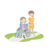 介護士に車椅子を引いてもらうおばあゃん