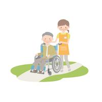 車椅子を引く介護士とおじいちゃん