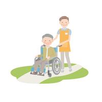 車椅子を引く男性介護士とおじいちゃん