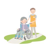 車椅子を引く男性介護士とおばあちゃん