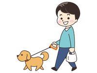 犬と散歩する若い男性