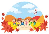 秋の日に草原でジャンプする元気な子供たち
