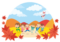 秋の日に草原でジャンプする元気な子供たち【