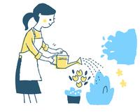 水やりをする主婦