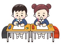 机で勉強する小学生の男女