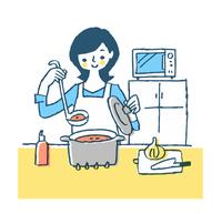 キッチンで調理をする主婦