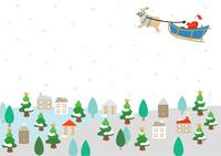 ソリを引くサンタクロースと雪景色の街並み