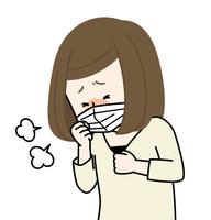 咳をする体調不良の女性