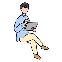 タブレットを操作している若い男性