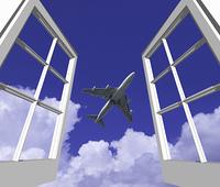 窓から旅客機と雲