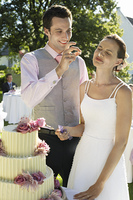 Groom Dotting Bride's Nose with Cake