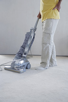 Man vacuuming the carpet
