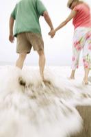 Couple Getting Feet Wet at Beach