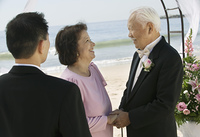 Groom With Parents on Beach