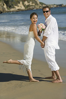 Excited Bride and Groom on Beach