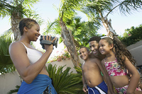 Mother Videotaping Family