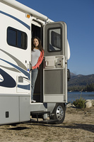 Woman Standing in RV Doorway