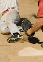 Close Play at Home Plate in Baseball Game