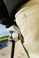 Hand Holding Golf Ball and Club