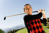 Golfer Watching Ball Drop